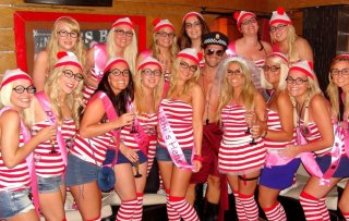 Alex toyboy with hens at Linekers Bar in Puerto Banus